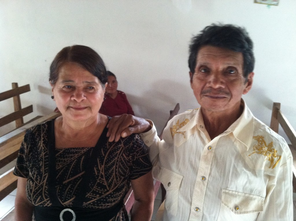 Couple pose for photo after Mass in Lodo Negro, Honduras.